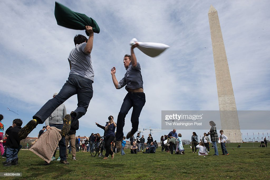 05 Alex Plunkett (left) and Sean Hart (right) both of Arlington, Virginia take part in a massive pillow fight on the National Mall in Washington, D.C. on April 05, 2014.