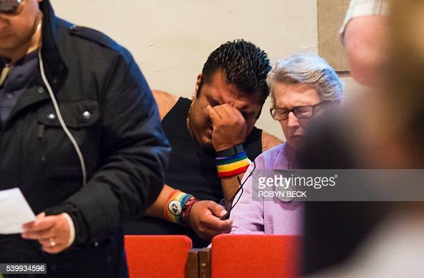 Alex Possner cries during a Eucharist and prayer against homophobia and gun violence June 13 2016 at All Saints Church in Pasadena California in...