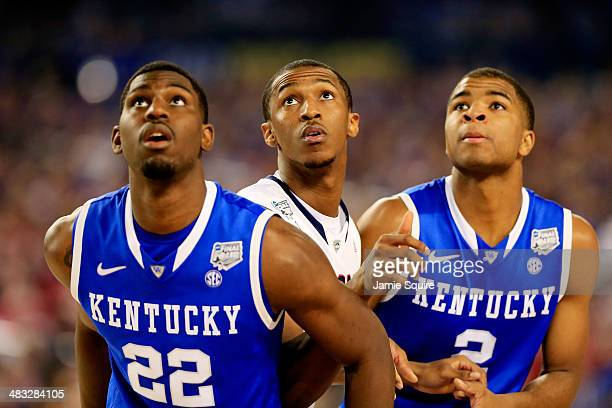 Alex Poythress and Aaron Harrison of the Kentucky Wildcats box out against Lasan Kromah of the Connecticut Huskies during the NCAA Men's Final Four...