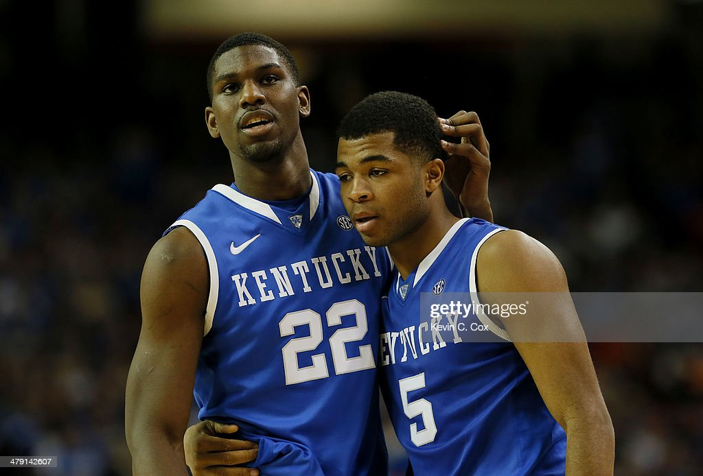 <a gi-track='captionPersonalityLinkClicked' href=/galleries/search?phrase=Alex+Poythress&family=editorial&specificpeople=7880790 ng-click='$event.stopPropagation()'>Alex Poythress</a> #22 and Andrew Harrison #5 of the Kentucky Wildcats react after Harrison was called for a foul in the first half against the Florida Gators during the Championship game of the 2014 Men's SEC Basketball Tournament at Georgia Dome on March 16, 2014 in Atlanta, Georgia.