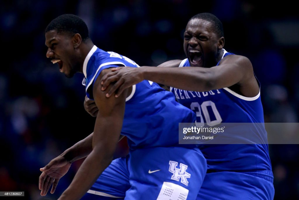 <a gi-track='captionPersonalityLinkClicked' href=/galleries/search?phrase=Alex+Poythress&family=editorial&specificpeople=7880790 ng-click='$event.stopPropagation()'>Alex Poythress</a> #22 and <a gi-track='captionPersonalityLinkClicked' href=/galleries/search?phrase=Julius+Randle&family=editorial&specificpeople=10784969 ng-click='$event.stopPropagation()'>Julius Randle</a> #30 of the Kentucky Wildcats celebrate defeating the Louisville Cardinals 74 to 69 during the regional semifinal of the 2014 NCAA Men's Basketball Tournament at Lucas Oil Stadium on March 28, 2014 in Indianapolis, Indiana.