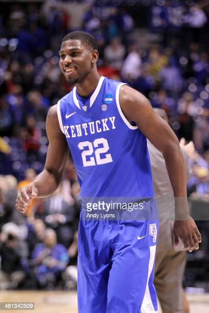 Alex Poythress of the Kentucky Wildcats celebrates defeating the Louisville Cardinals 74 to 69 during the regional semifinal of the 2014 NCAA Men's...