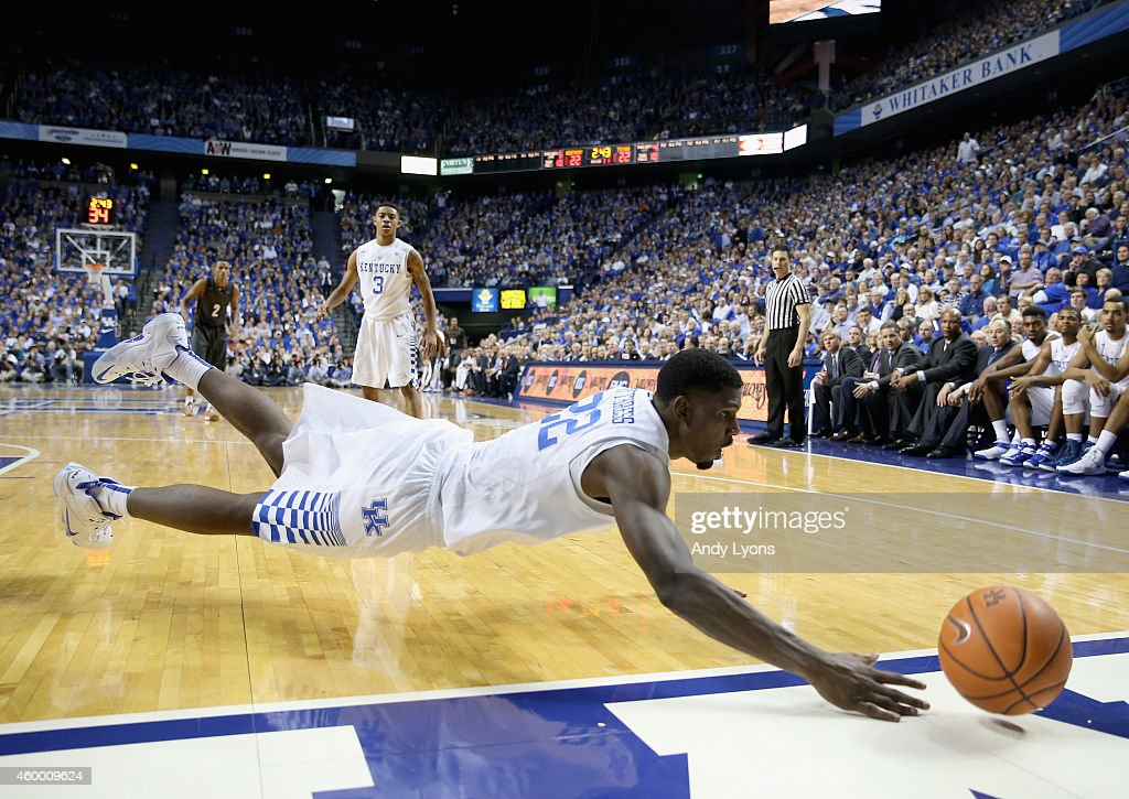 <a gi-track='captionPersonalityLinkClicked' href=/galleries/search?phrase=Alex+Poythress&family=editorial&specificpeople=7880790 ng-click='$event.stopPropagation()'>Alex Poythress</a> #22 of the Kentucky Wildcats dives for a loose ball during the game against the Texas Longhorns at Rupp Arena on December 5, 2014 in Lexington, Kentucky.