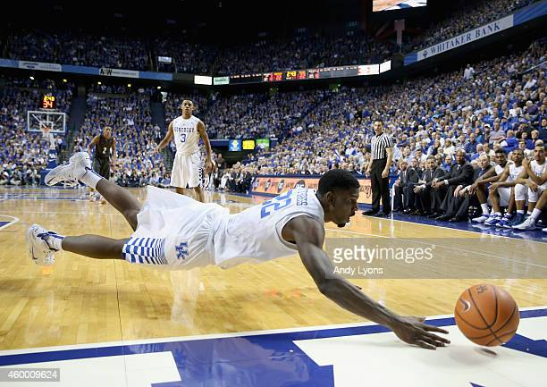 Alex Poythress of the Kentucky Wildcats dives for a loose ball during the game against the Texas Longhorns at Rupp Arena on December 5 2014 in...