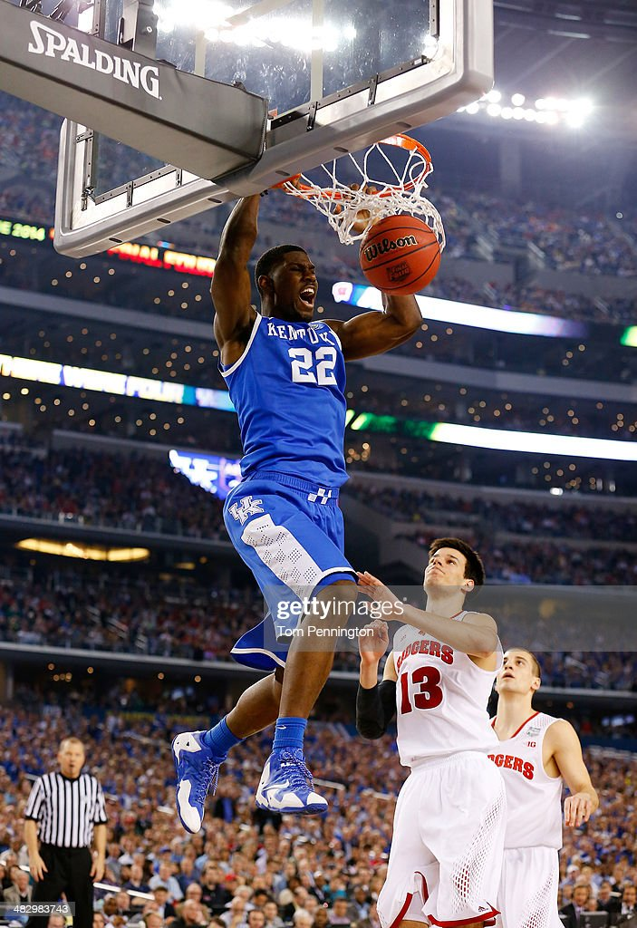 <a gi-track='captionPersonalityLinkClicked' href=/galleries/search?phrase=Alex+Poythress&family=editorial&specificpeople=7880790 ng-click='$event.stopPropagation()'>Alex Poythress</a> #22 of the Kentucky Wildcats dunks as Duje Dukan #13 of the Wisconsin Badgers defends during the NCAA Men's Final Four Semifinal at AT&T Stadium on April 5, 2014 in Arlington, Texas.