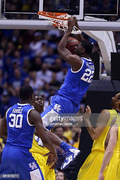 Alex Poythress of the Kentucky Wildcats dunks the ball over Caris LeVert of the Michigan Wolverines in the first half during the midwest regional...