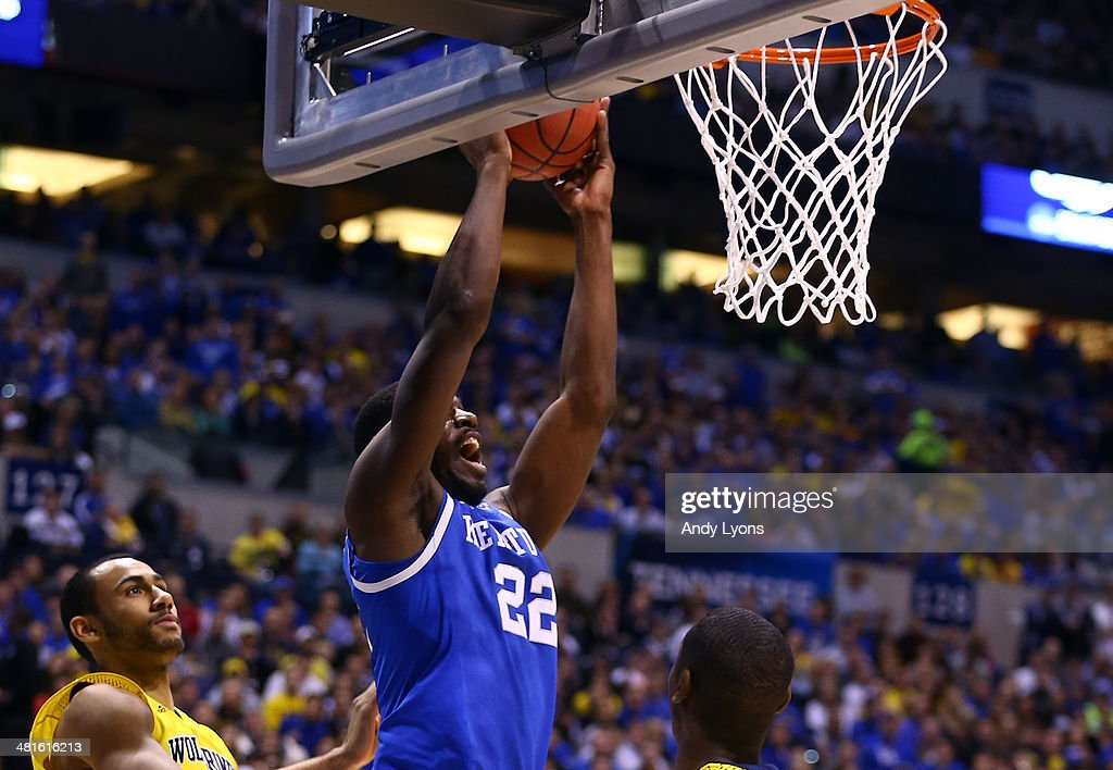 Alex Poythress #22 of the Kentucky Wildcats dunks the ball over Caris LeVert #23 of the Michigan Wolverines in the first half during the midwest regional final of the 2014 NCAA Men's Basketball Tournament at Lucas Oil Stadium on March 30, 2014 in Indianapolis, Indiana.