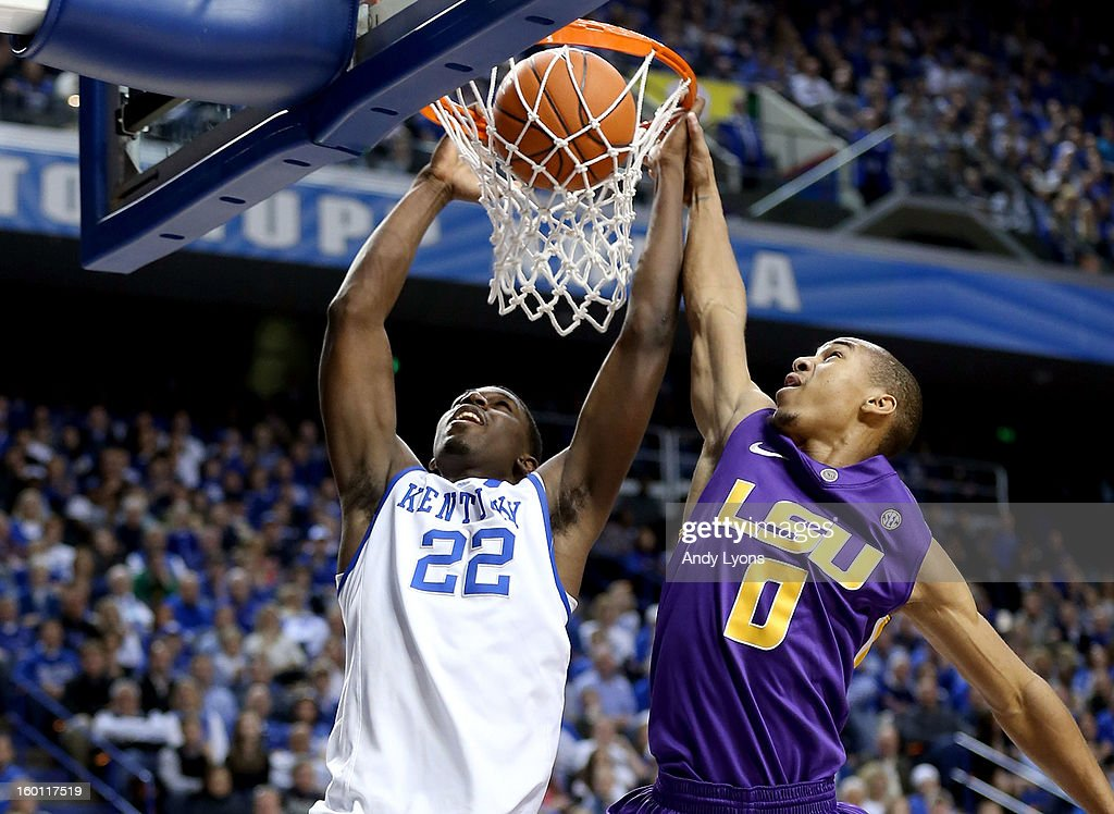 Alex Poythress #22 of the Kentucky Wildcats dunks the ball while defended by Charles Carmouche #0 the LSU Tigers during the game at Rupp Arena on January 26, 2013 in Lexington, Kentucky.