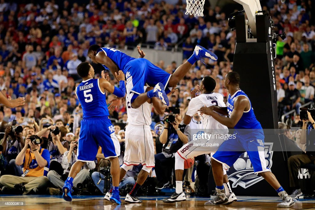<a gi-track='captionPersonalityLinkClicked' href=/galleries/search?phrase=Alex+Poythress&family=editorial&specificpeople=7880790 ng-click='$event.stopPropagation()'>Alex Poythress</a> #22 of the Kentucky Wildcats falls over <a gi-track='captionPersonalityLinkClicked' href=/galleries/search?phrase=DeAndre+Daniels&family=editorial&specificpeople=8607612 ng-click='$event.stopPropagation()'>DeAndre Daniels</a> #2 of the Connecticut Huskies during the NCAA Men's Final Four Championship at AT&T Stadium on April 7, 2014 in Arlington, Texas.