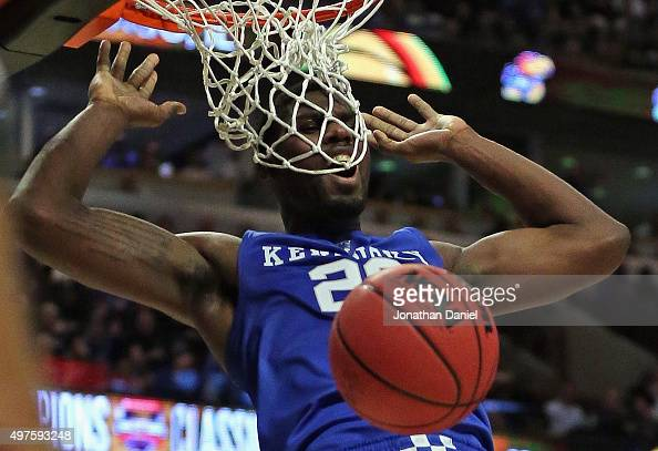 Alex Poythress of the Kentucky Wildcats gets his face caught in the net while dunknig against the Duke Blue Devils during the Champions Classic at...