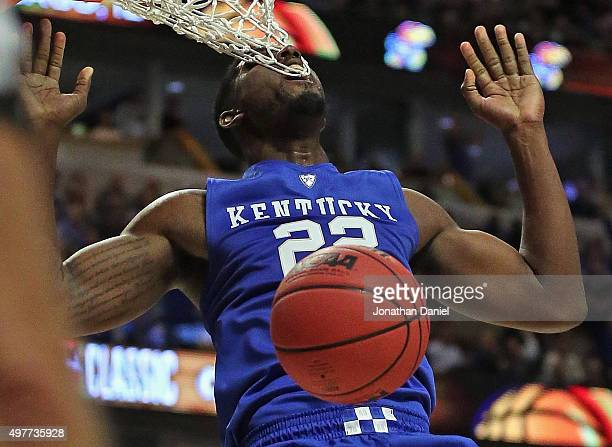 Alex Poythress of the Kentucky Wildcats gets his teeth caught in the net while dunknig against the Duke Blue Devils during the Champions Classic at...