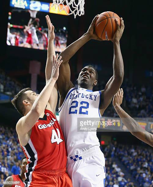 Alex Poythress of the Kentucky Wildcats shoots the ball while defended by Nemanja Djurisic of the Georgia Bulldogs during the game at Rupp Arena on...