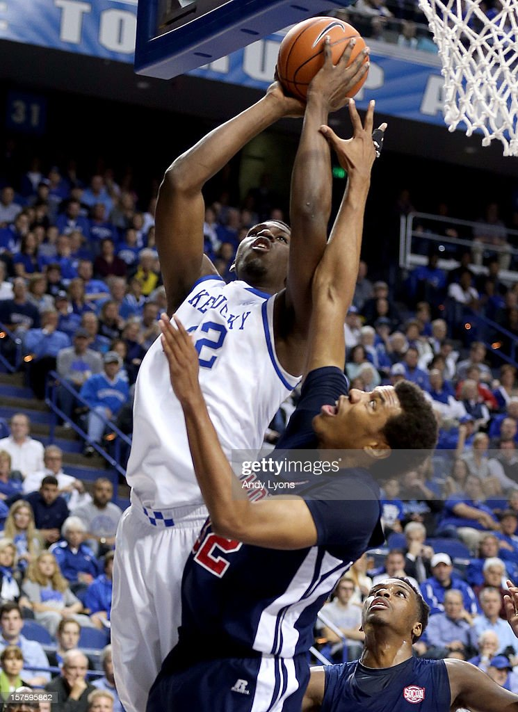 Alex Poythress #22 of the Kentucky Wildcats shoots the ball while defended by Tim Williams #32 of the Samford Bulldogs during the game at Rupp Arena on December 4, 2012 in Lexington, Kentucky. Kentucky won 88-56.