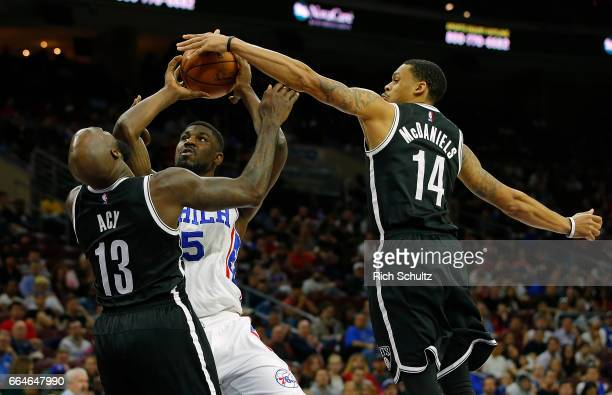 Alex Poythress of the Philadelphia 76ers attempts a shot as Quincy Acy and KJ McDaniels of the Brooklyn Nets defend in the second half during an NBA...
