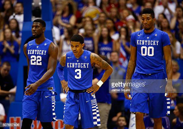 Alex Poythress Tyler Ulis and Marcus Lee of the Kentucky Wildcats walk off the court during a timeout in the game against the Kansas Jayhawks at...