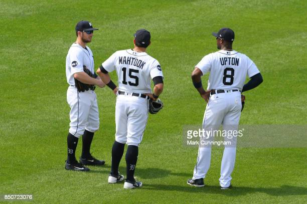 Alex Presley Mikie Mahtook and Justin Upton of the Detroit Tigers stand together in the outfield during the game against the Minnesota Twins at...