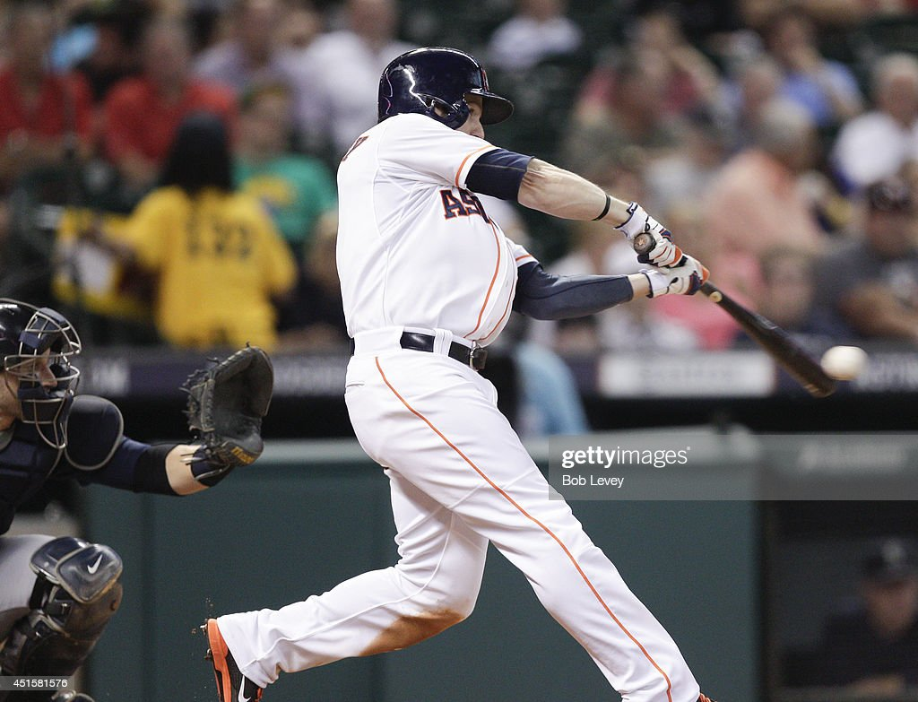 Alex Presley #8 of the Houston Astros singles in the third inning against the Seattle Mariners at Minute Maid Park on July 1, 2014 in Houston, Texas.