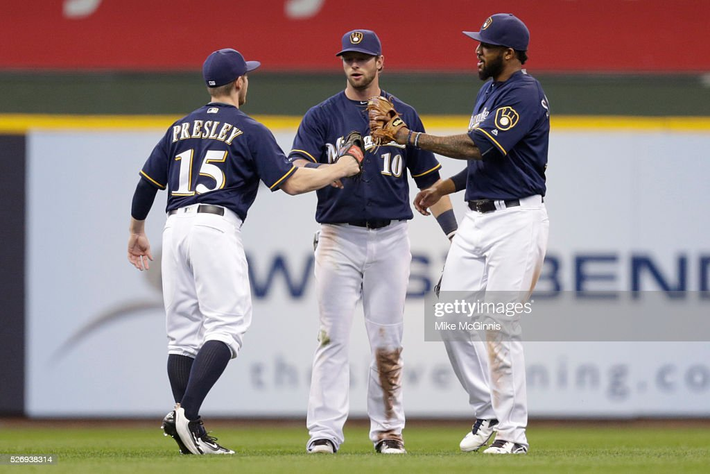 Alex Presley #15 of the Milwaukee Brewers celebrates with Kirk Nieuwenhuis #10 and Domingo Santana #16 after the 14-5 win over the Miami Marlins at Miller Park on May 01, 2016 in Milwaukee, Wisconsin.