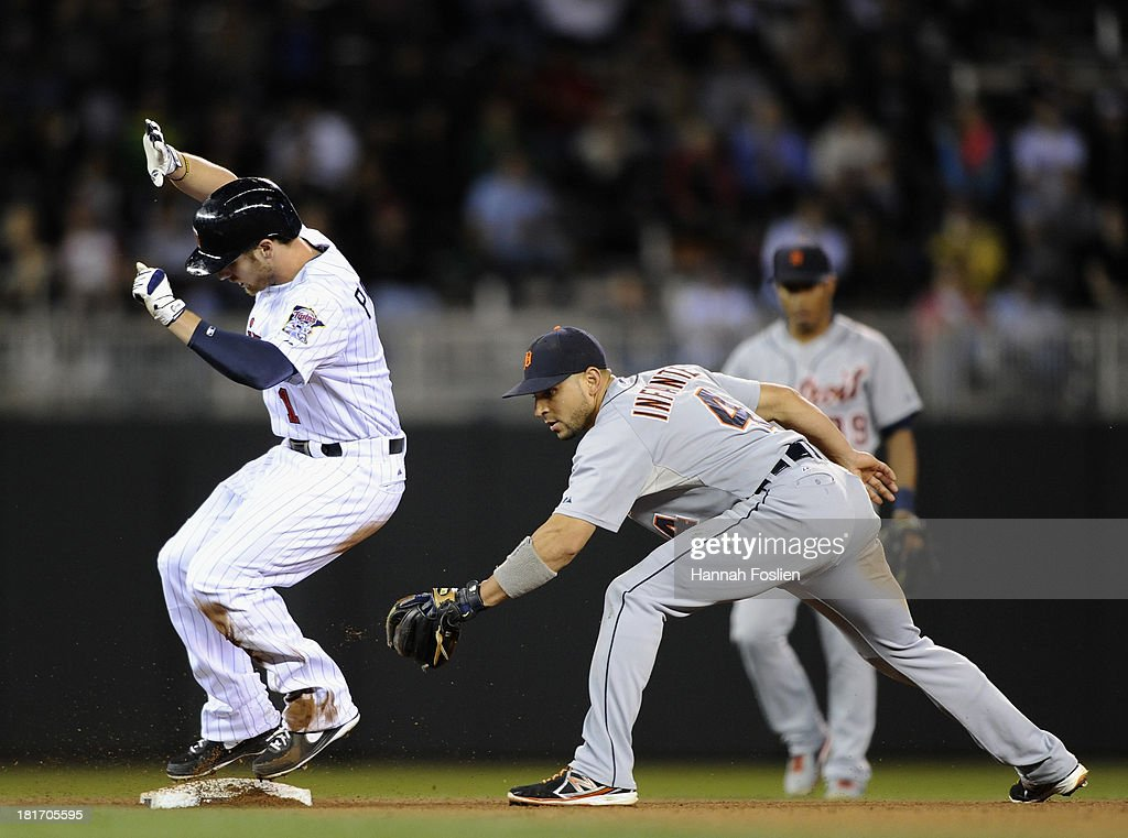 Alex Presley #1 of the Minnesota Twins is safe at second base as <a gi-track='captionPersonalityLinkClicked' href=/galleries/search?phrase=Omar+Infante&family=editorial&specificpeople=203255 ng-click='$event.stopPropagation()'>Omar Infante</a> #4 of the Detroit Tigers fields the ball during the fifth inning of the game on September 23, 2013 at Target Field in Minneapolis, Minnesota.