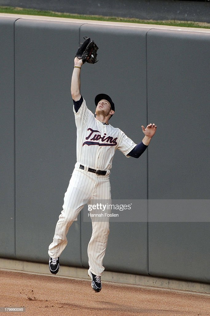 Alex Presley #1 of the Minnesota Twins makes a catch in center field of the ball hit by J.P. Arencibia #9 of the Toronto Blue Jays during the fourth inning of the game on September 7, 2013 at Target Field in Minneapolis, Minnesota.