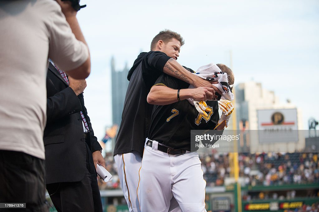 Alex Presley #7 of the Pittsburgh Pirates gets a shaving cream pie in the face from teammate A.J. Burnett #34 during game one of a twilight doubleheader against the St. Louis Cardinals at PNC Park on July 30, 2013 in Pittsburgh, Pennsylvania.