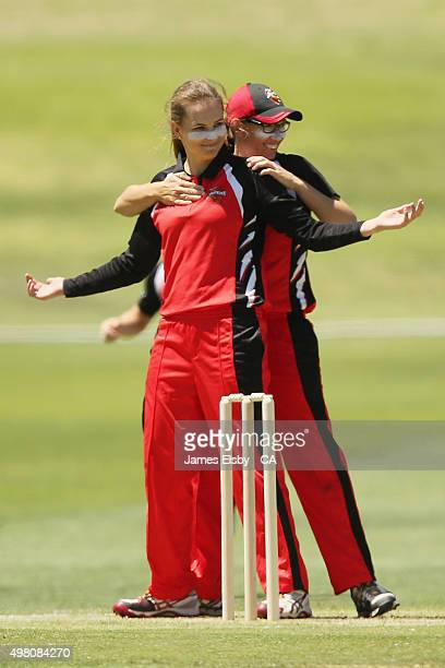 Alex Price and Lauren Ebsary of the Scorpions celebrate a wicket during the WNCL match between South Australia and Queensland at Railsways Oval on...