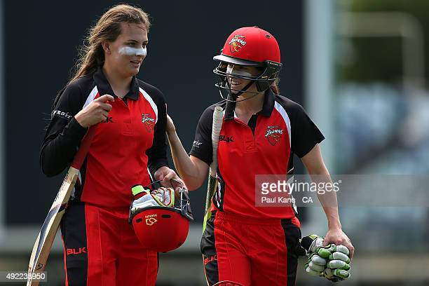 Alex Price and Megan Schutt of South Australia walk from the field at the conclusion of their innings during the round one WNCL match between Western...
