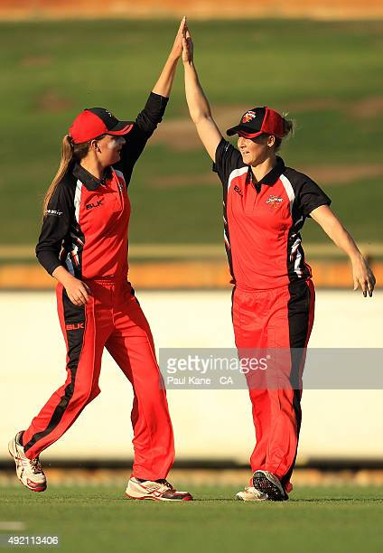 Alex Price and Sophie Devine of South Australia celebrate the wicket of Sarah Aley of New South Wales during the round one WNCL match between New...