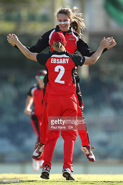 Alex Price of South Australia celebrates with Lauren Ebsary after dismissing Nicole Bolton of Western Australia during the round one WNCL match...