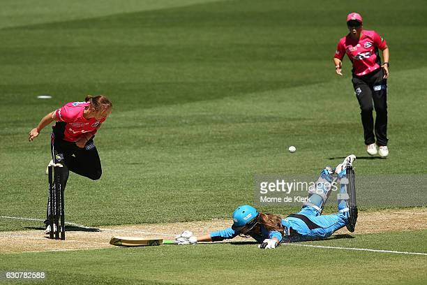 Alex Price of the Adelaide Strikers avoids being runout during the WBBL match between the Sixers and Strikers on January 2 2017 in Adelaide Australia