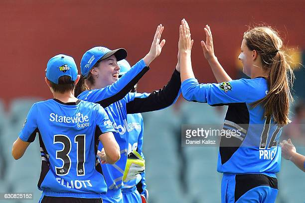 Alex Price of the Adelaide Strikers celebrates with her team mates after taking a wicket during the WBBL match between the Strikers and Sixers at the...