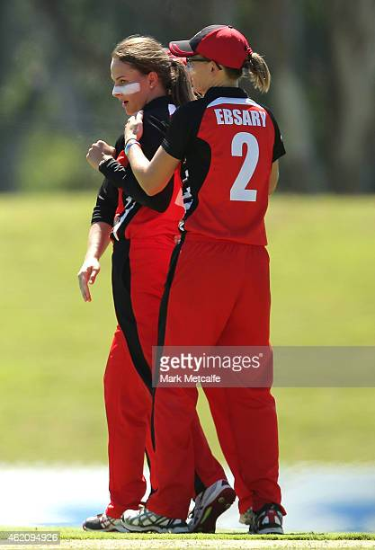 Alex Price of the Scorpions celebrates with team mates after taking the wicket of Alyssa Healy of the Breakers during the WNCL Final match between...