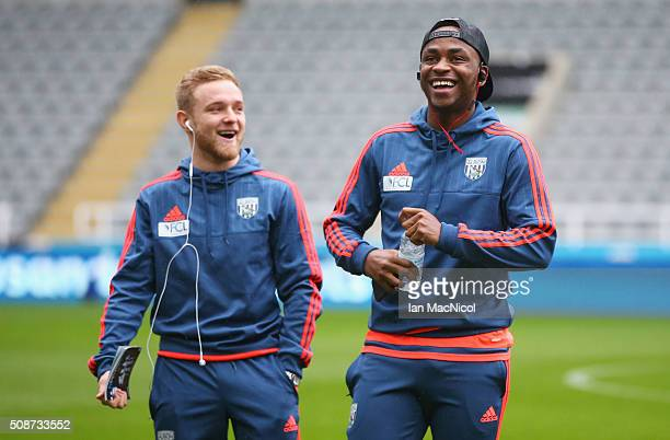 Alex Pritchard and Saido Berahino of West Bromwich Albion are seen prior to the Barclays Premier League match between Newcastle United and West...