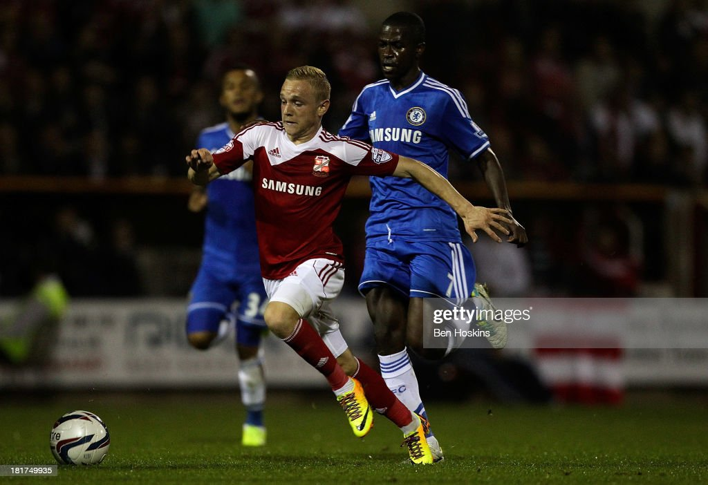 Alex Pritchard of Swindon holds off pressure from Ramires of Chelsea during the Capital One Cup third round match between Swindon Town and Chelsea at County Ground on September 24, 2013 in Swindon, England.