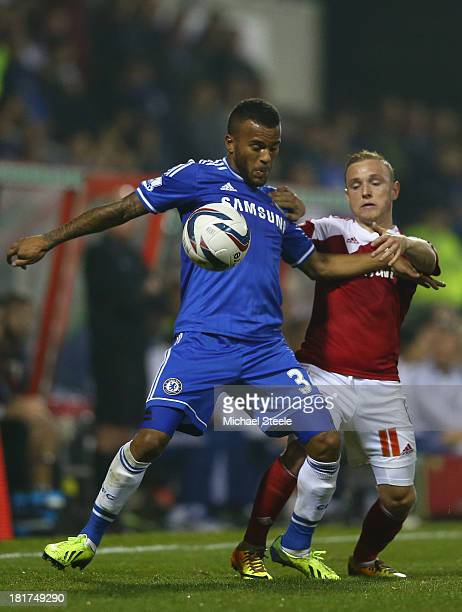 Alex Pritchard of Swindon Town is held back by Ryan Bertrand of Chelsea during the Capital One Cup third round match between Swindon Town and Chelsea...