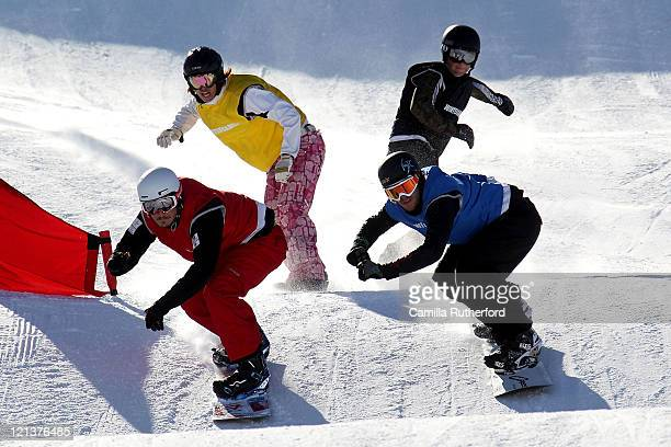 Alex Pullin of Australia and Chris Mahaney of the USA compete in the Snowboard Cross Semi Final during day seven of the Winter Games NZ at Cardrona...