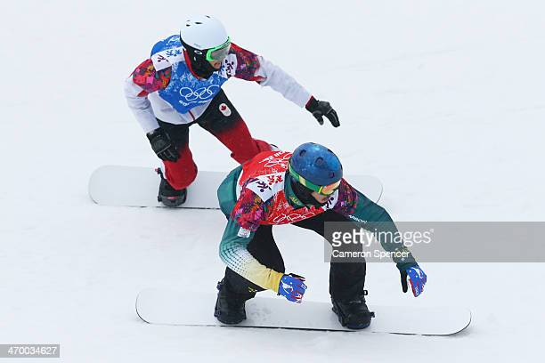 Alex Pullin of Australia and Kevin Hill of Canada compete in the Men's Snowboard Cross 1/8 Finals on day eleven of the 2014 Winter Olympics at Rosa...