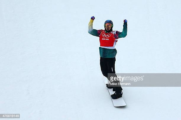 Alex Pullin of Australia celebrates after his heat in the Men's Snowboard Cross 1/8 Finals on day eleven of the 2014 Winter Olympics at Rosa Khutor...