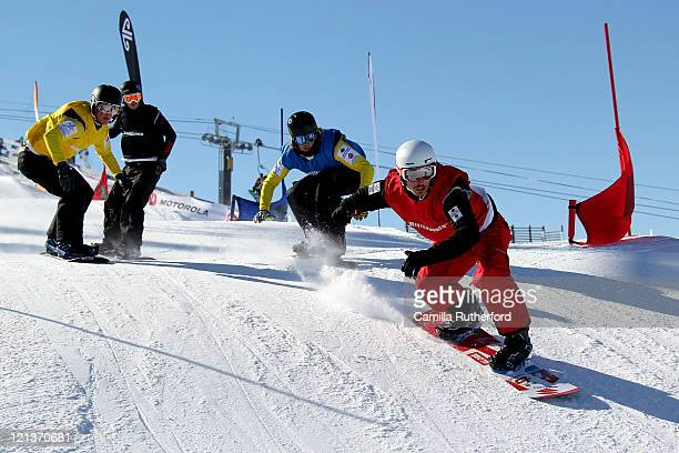 Alex Pullin of Australia leads the field in the Snowboard Cross Final during day seven of the Winter Games NZ at Cardrona Alpine Resort on August 19...