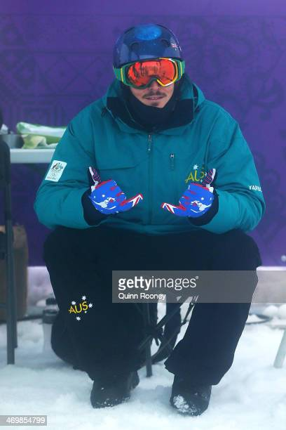 Alex Pullin of Australia looks on as competition is delayed due to weather conditions ahead of the Men's Snowboard Cross Seeding on day ten of the...