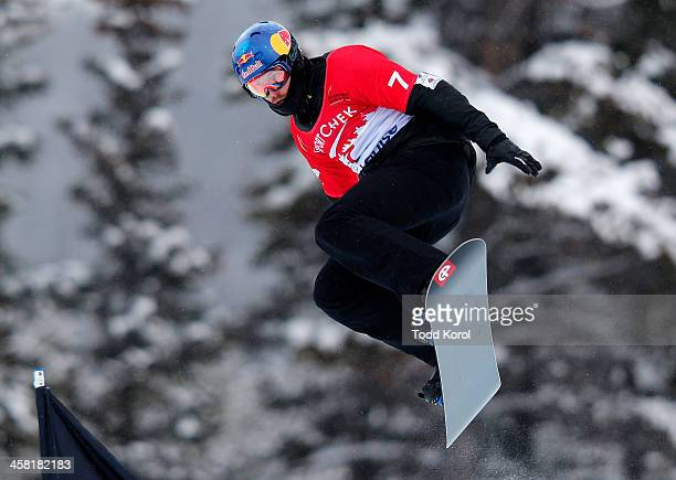Alex Pullin of Australia takes to the air during the men's qualification run at the FIS Snowboard Cross World Cup December 20 2013 in Lake Louise...
