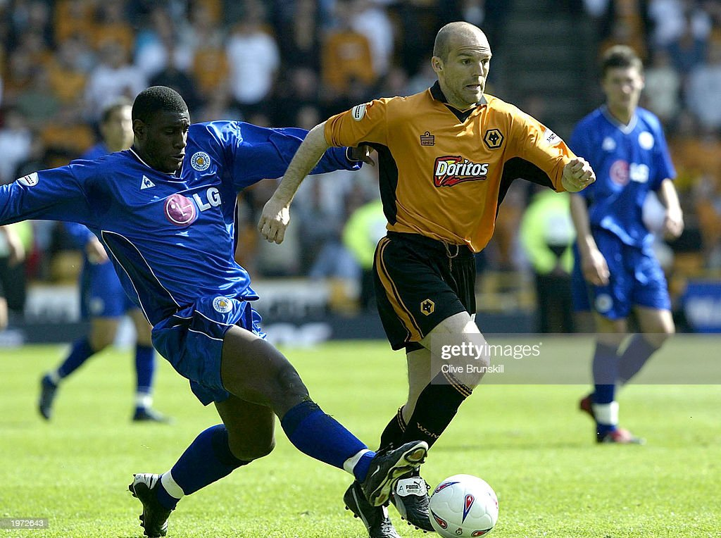 Alex Rae of Wolves is tackled by Trevor Benjamin of Leicester during the The Nationwide First Division match between Wolverhampton Wanderers and Leicester City on May 4, 2003 at the Molineux Stadium in Wolverhampton, England.