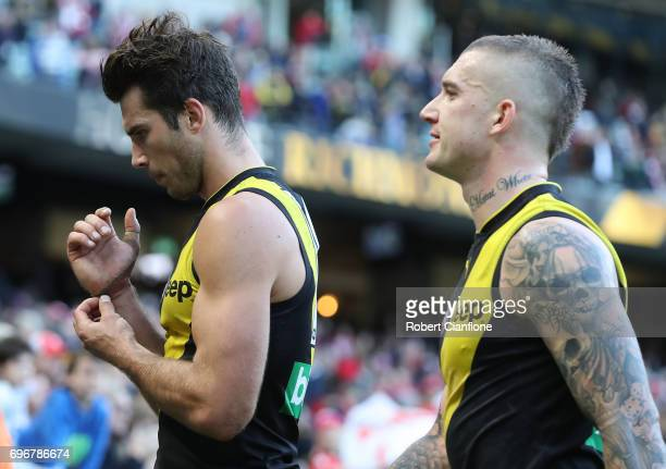 Alex Rance and Dustin Martin of the Tigers walk from the ground after the Tigers were defeated by the Swans during the round 13 AFL match between the...