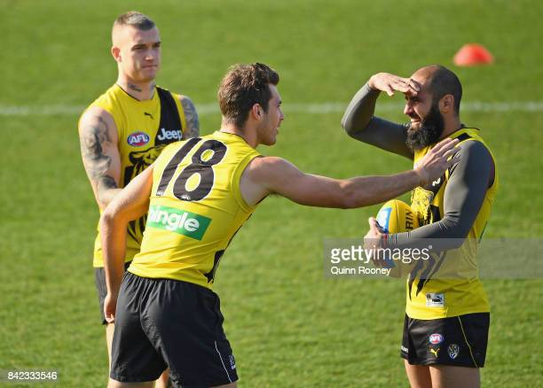 Alex Rance Dustin Martin and Bachar Houli of the Tigers chat during a Richmond Tigers AFL training session at Punt Road Oval on September 4 2017 in...