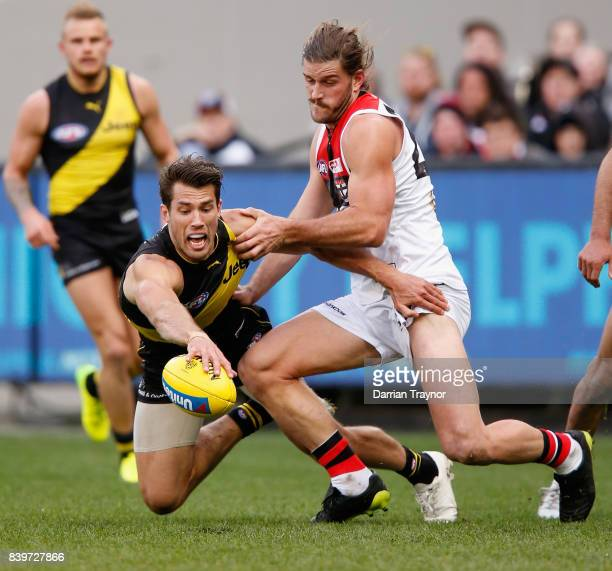 Alex Rance of the Tigers and Josh Bruce of the Saints compete during the round 23 AFL match between the Richmond Tigers and the St Kilda Saints at...
