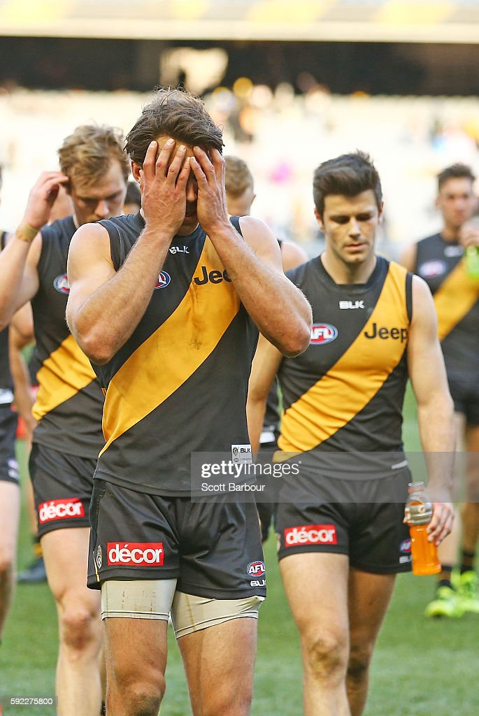 Alex Rance of the Tigers and Trent Cotchin of the Tigers lead the players from the field after losing the round 22 AFL match between the Richmond...