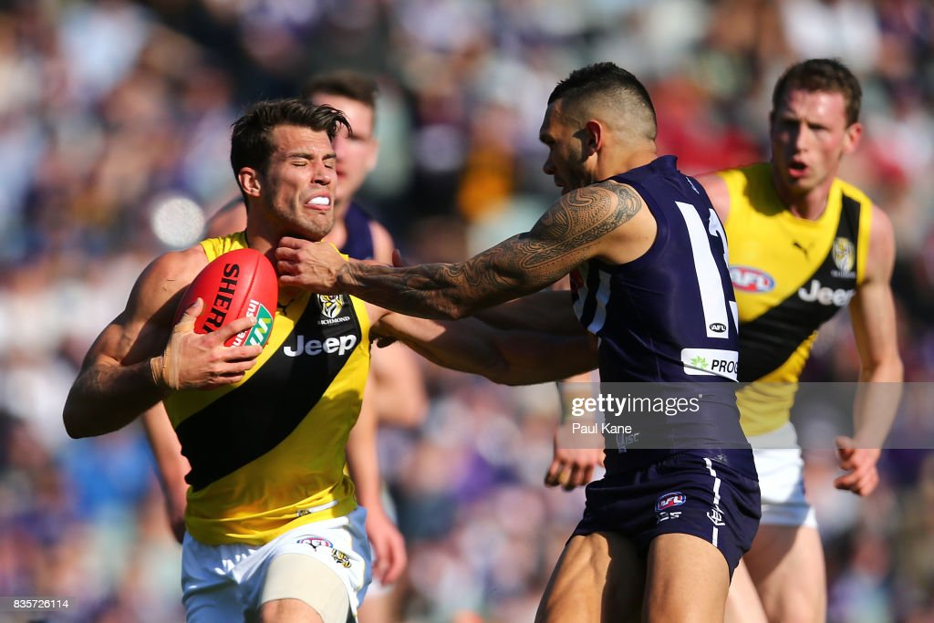 Alex Rance of the Tigers attempts to break from a tackle by Harley Bennell of the Dockers during the round 22 AFL match between the Fremantle Dockers and the Richmond Tigers at Domain Stadium on August 20, 2017 in Perth, Australia.