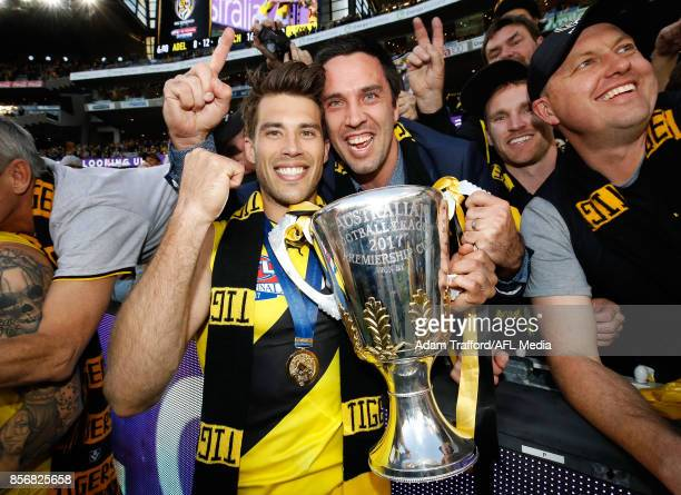 Alex Rance of the Tigers celebrates with former Tigers teammate Troy Chaplin during the 2017 Toyota AFL Grand Final match between the Adelaide Crows...