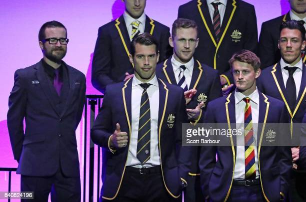 Alex Rance of the Tigers gestures after being named captain of the AFL All Australian team as they pose on stage during the AFL All Australian team...