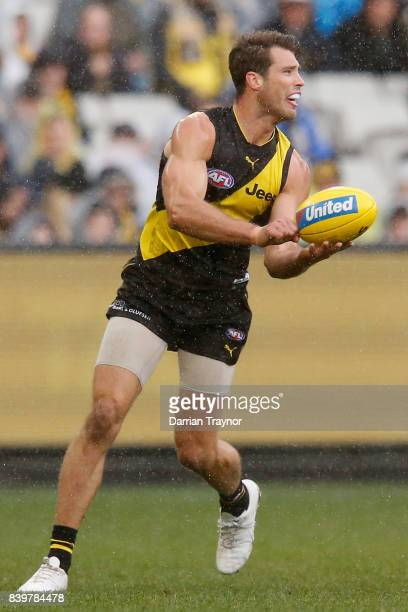 Alex Rance of the Tigers handballs during the round 23 AFL match between the Richmond Tigers and the St Kilda Saints at Melbourne Cricket Ground on...